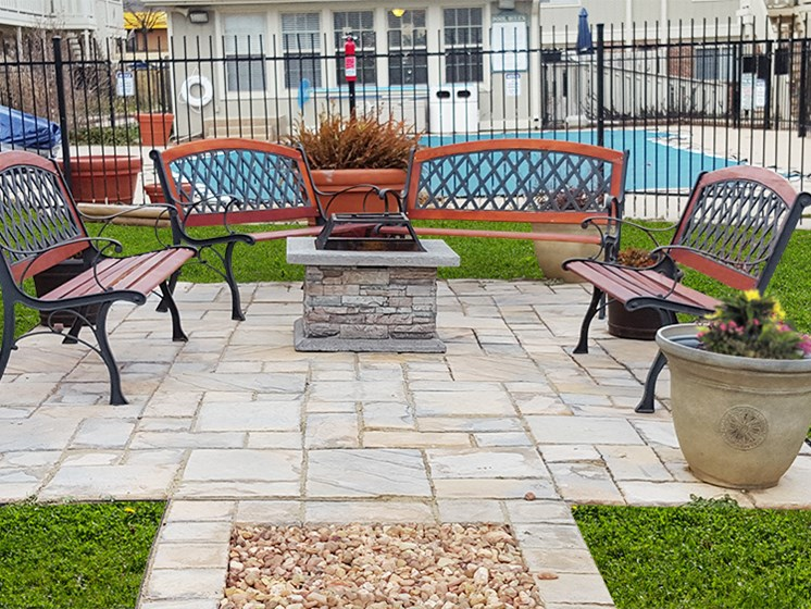 Outdoor space with fire pit at Hearth Hollow Apartments in Derby, KS