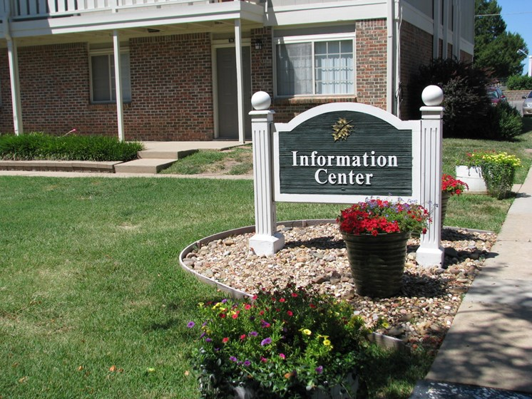 Office sign at Hearth Hollow Apartments in Derby, KS