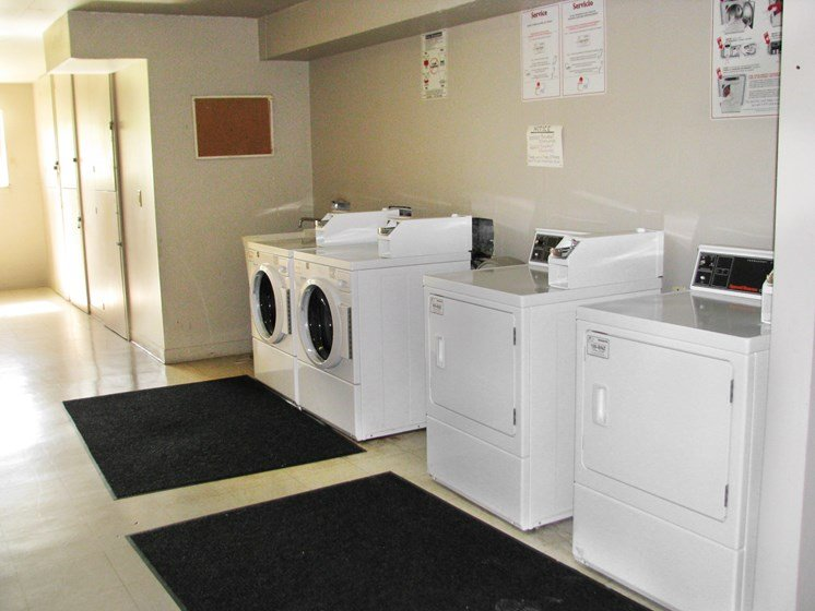 Community Laundry room at Hearth Hollow Apartments in Derby, KS