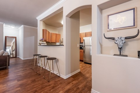 Open concept floor plans with wood style flooring.