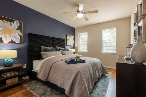 Large bedrooms with ceiling fans and wood-style flooring.