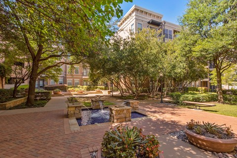 Two lavish courtyards with lush landscaping and fountains..