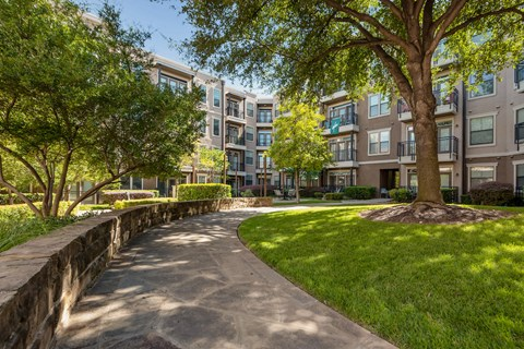 Lush courtyards with mature trees and walking trails.