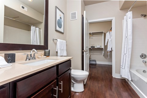 Spacious bathrooms with extra storage, ceramic tile, and custom framed mirrors.