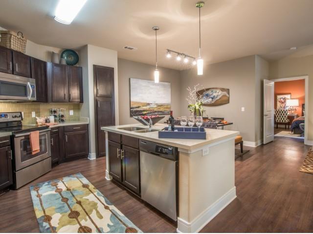 Luxurious kitchen, stainless steel appliances, stunning large islands.