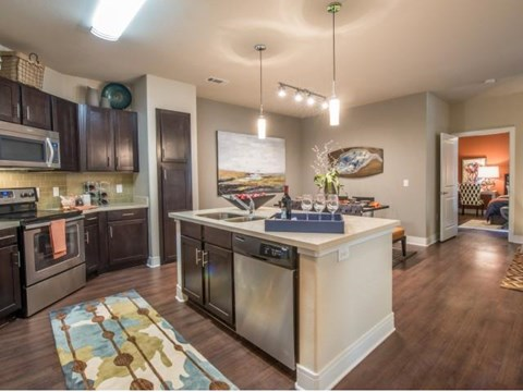 Luxurious kitchen, stainless steel appliances, stunning large islands.