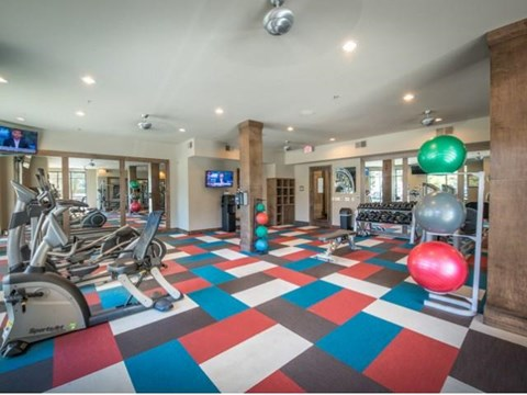 Fitness center with strength training and smart technology cardio machines