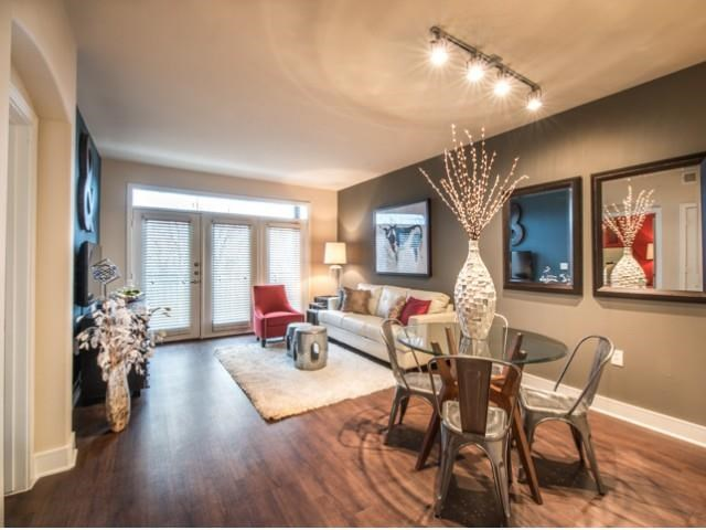 Spacious living room  and dinning room with faux hardwood floors, beautiful natural light and open floor plan.