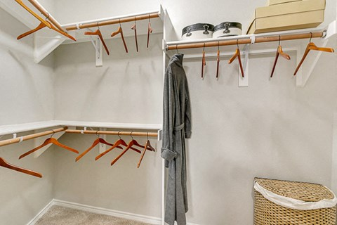 Spacious walk in closets with built in storage.