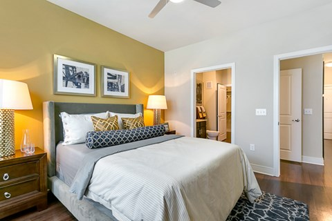 Spacious bedroom large enough to fit a king size bed with luxurious faux wood flooring and modern ceiling fan, beautiful natural light.
