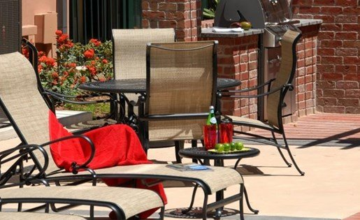 Seating by the Pool at La Maison River Oaks Apartments in Houston, Texas