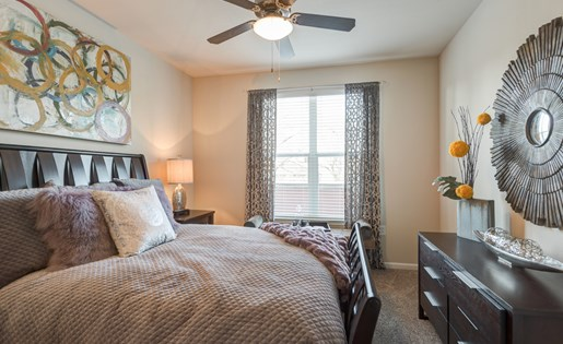 Bedroom With Ceiling Fan at La Maison River Oaks Apartments in Houston, Texas