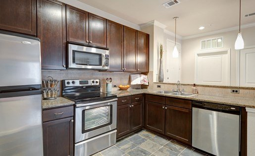 Fully-Equipped Kitchen at La Maison River Oaks Apartments in Houston, Texas