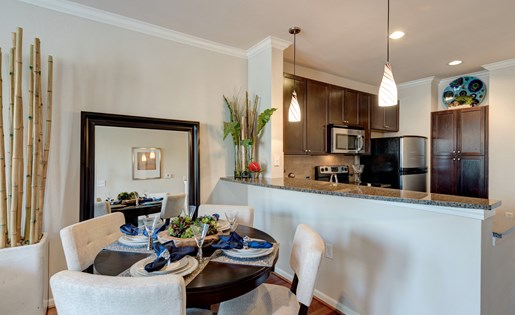 Kitchen and Dining Area at La Maison River Oaks Apartments in Houston, Texas