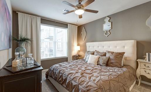 Master Bedroom at La Maison River Oaks Apartments in Houston, Texas