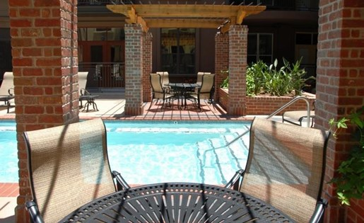 Pool Seating at La Maison River Oaks Apartments in Houston, Texas