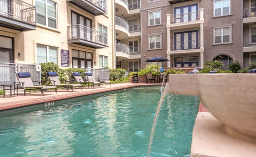 Relax by the Pool at La Maison River Oaks Apartments in Houston, Texas