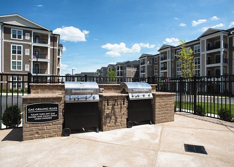 Outdoor Space Grilling Kitchen at Abberly at Southpoint Apartment Homes by HHHunt, Fredericksburg, VA