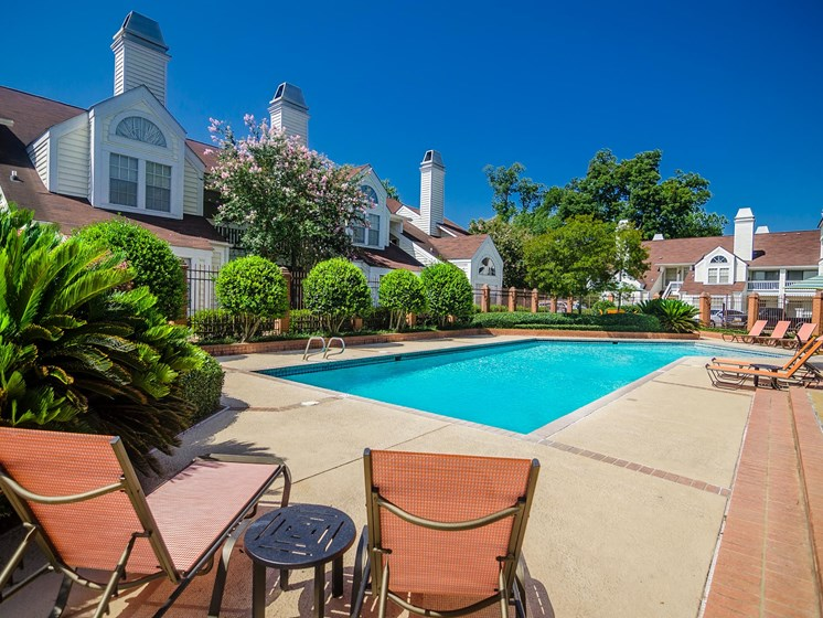 Outdoor swimming pool at Rosewood Apartments in Alexandria, LA