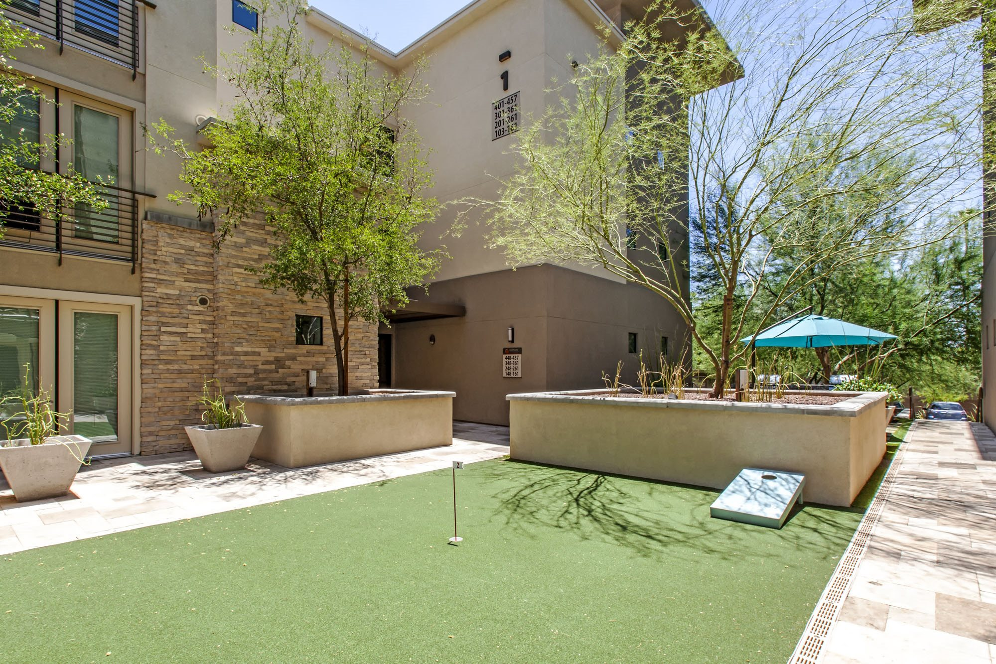 Private resident putting green and outdoor kitchen