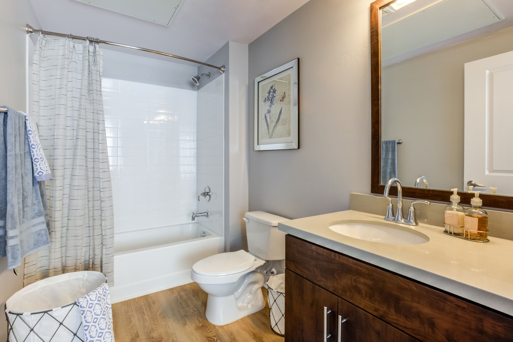 Apartments in Phoenix -Biltmore at Camelback Bathroom with Hardwood Floors and Large Tub