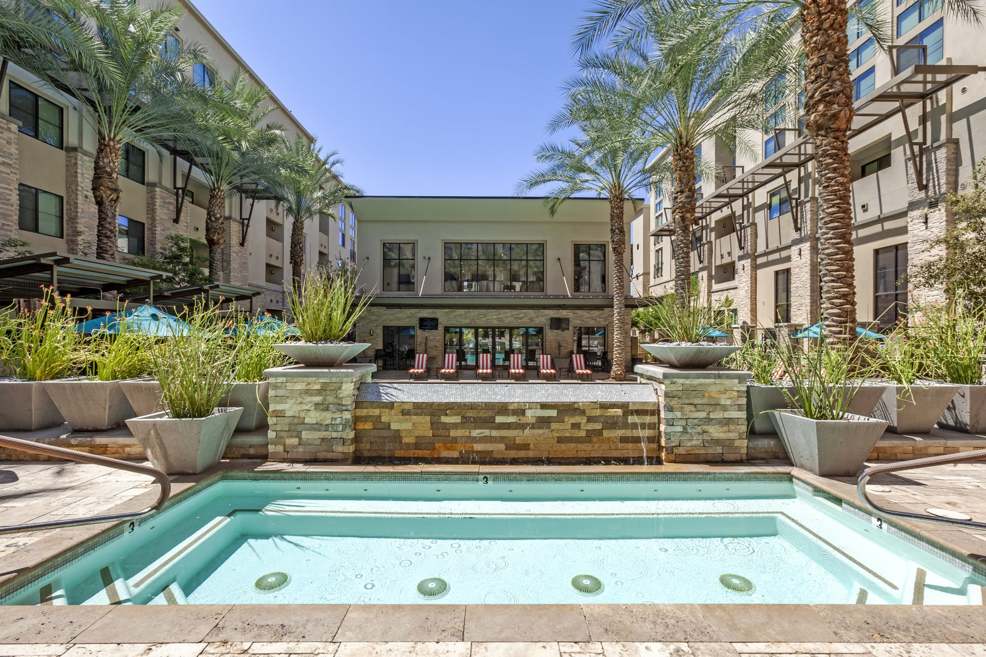Phoenix Luxury Apartments -Biltmore at Camelback Sparkling Pool with Lounge Chairs and Cabanas