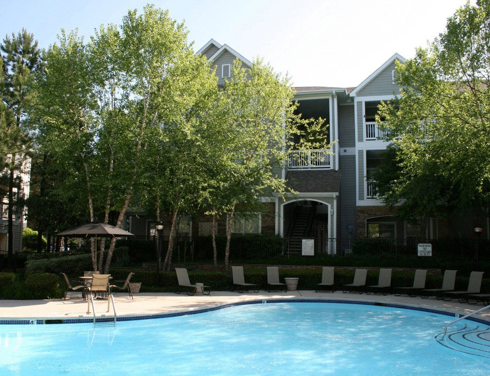 Lounging by the Pool at Lodge at Mallard Creek Apartments, 7815 Chelsea Jade Lane, Charlotte, North Carolina
