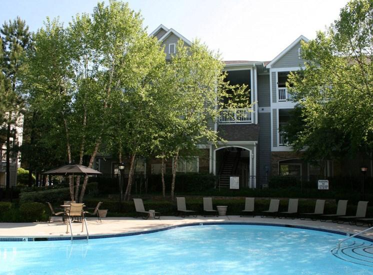 Lounging by the Pool at Lodge at Mallard Creek Apartments, 7815 Chelsea Jade Lane, Charlotte, North Carolina