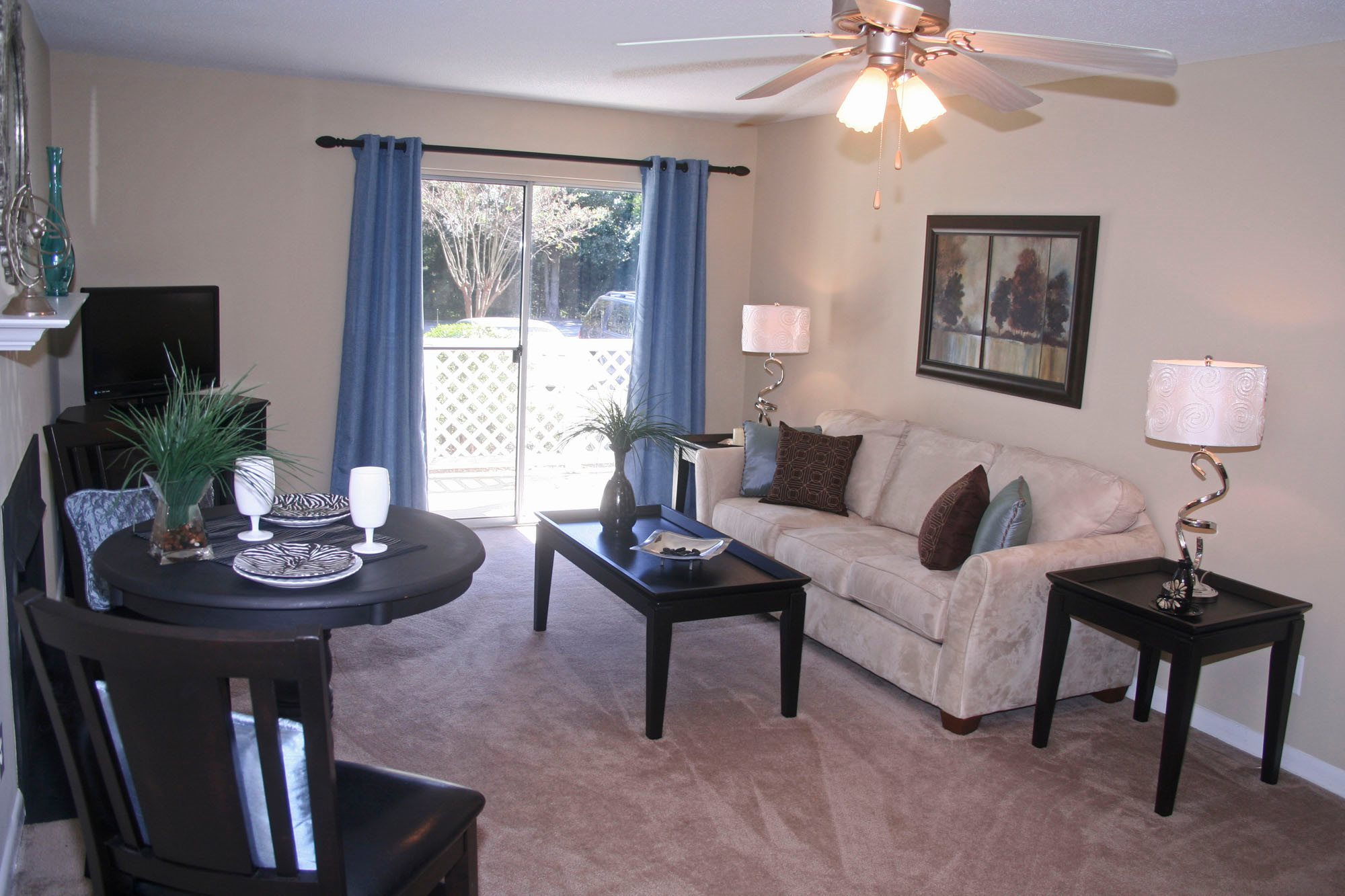 Spacious Living Room With Ceiling Fan with Lights at Cypress Pointe