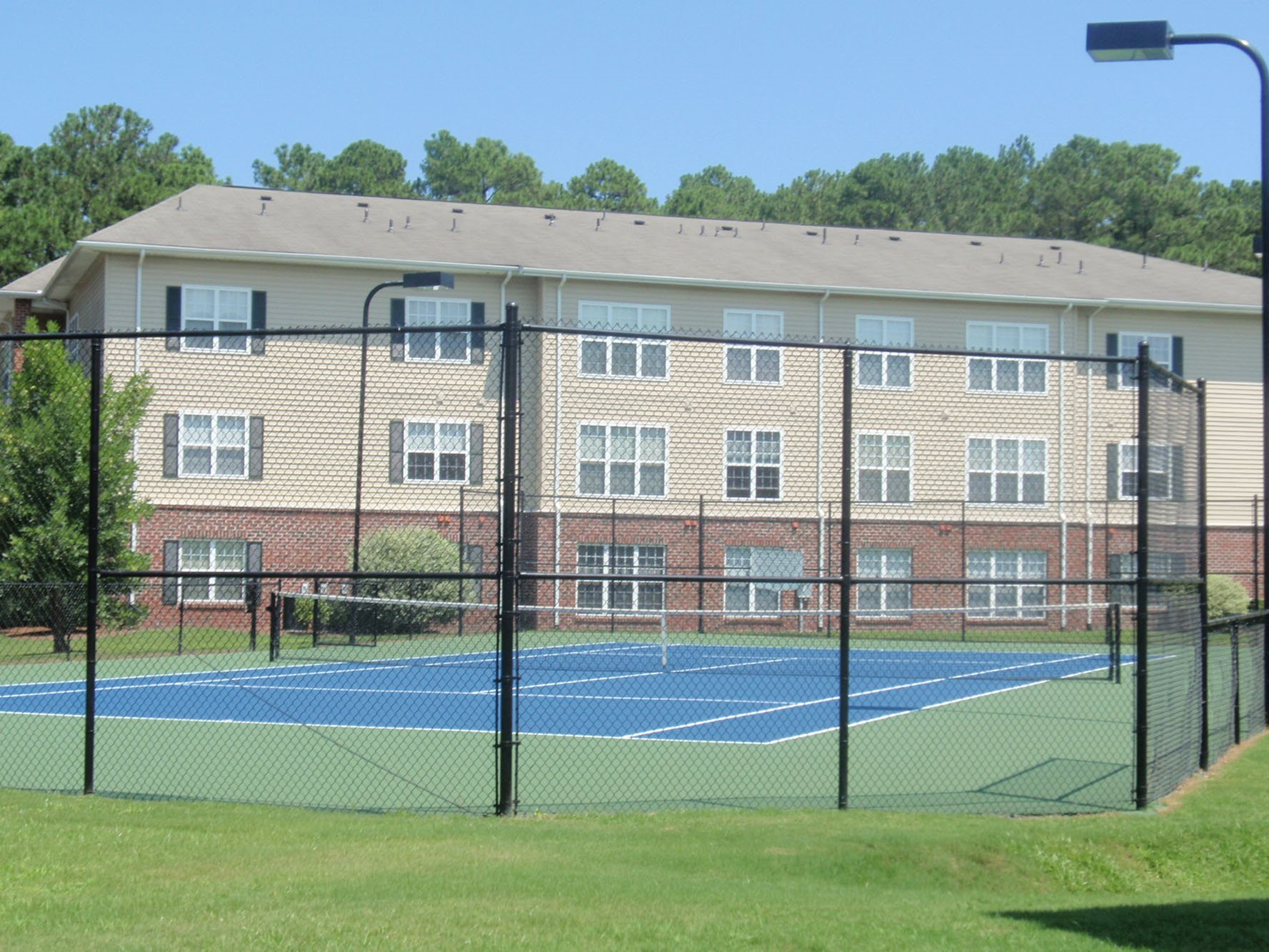 Lighted Tennis Court with Pavilion at Woodland Crossing, 28562