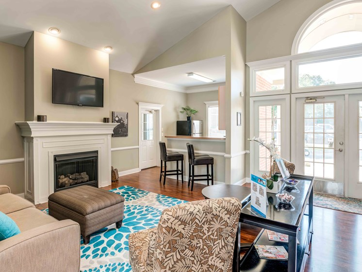 Posh Lounge Area In Clubhouse Is Perfect For Meeting Up With Friends at Woodland Crossing Apartments, New Bern, NC, 28562