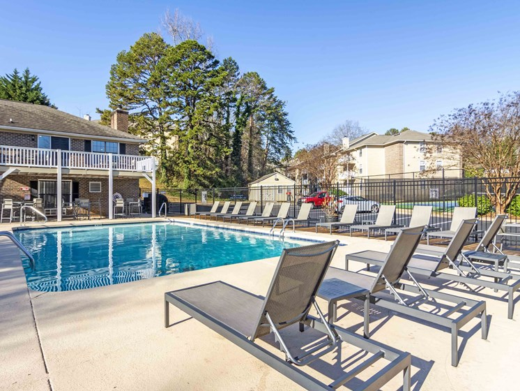 Pool Side Relaxing Area With Sundeck at Northtowne Village Apartments, Hixson, TN, 37343