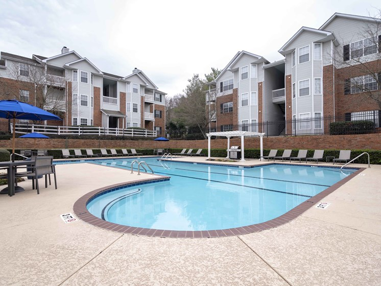 Umbrella Shaded Chairs by Pool at Waterford Landing Apartments, Tennessee, 37076