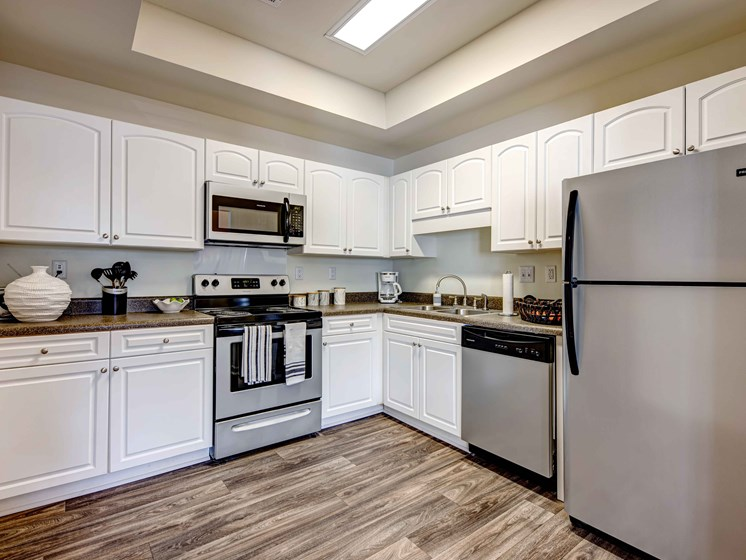 White Cabinetry And Appliances In Kitchen at Forest Ridge Apartments, Tennessee, 37931