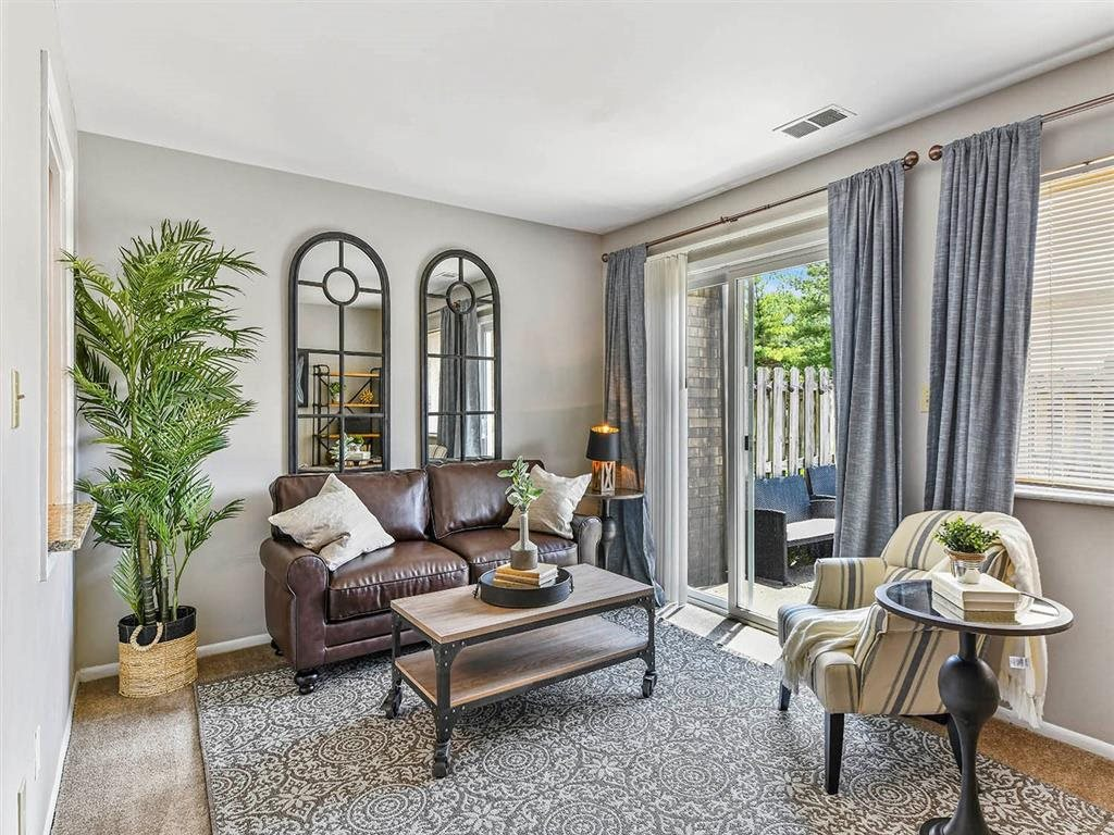 Living Room With Doorway to Balcony at Westpark Townhomes, Indianapolis