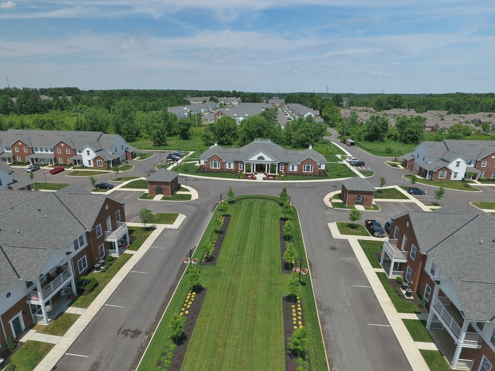 Drone shot aerial of roads and apartments