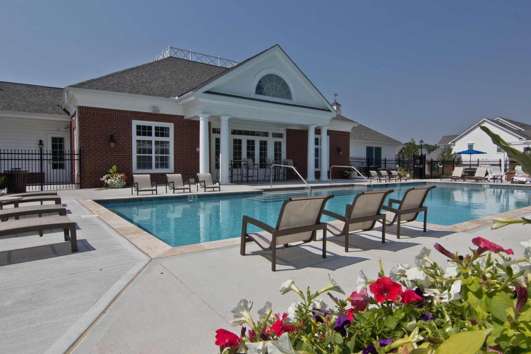 Pool and chairs behind clubhouse