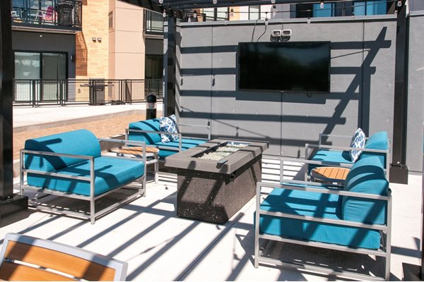 Sundeck with TV lounges and Fire Pit at The Axis, Plymouth, Minnesota