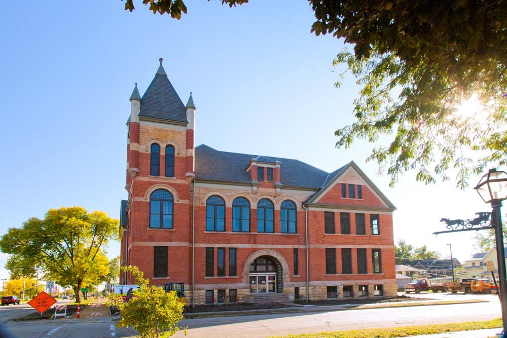Roosevelt School is a two story brick building with large historic windows and a tower in the northeast corner of the building.