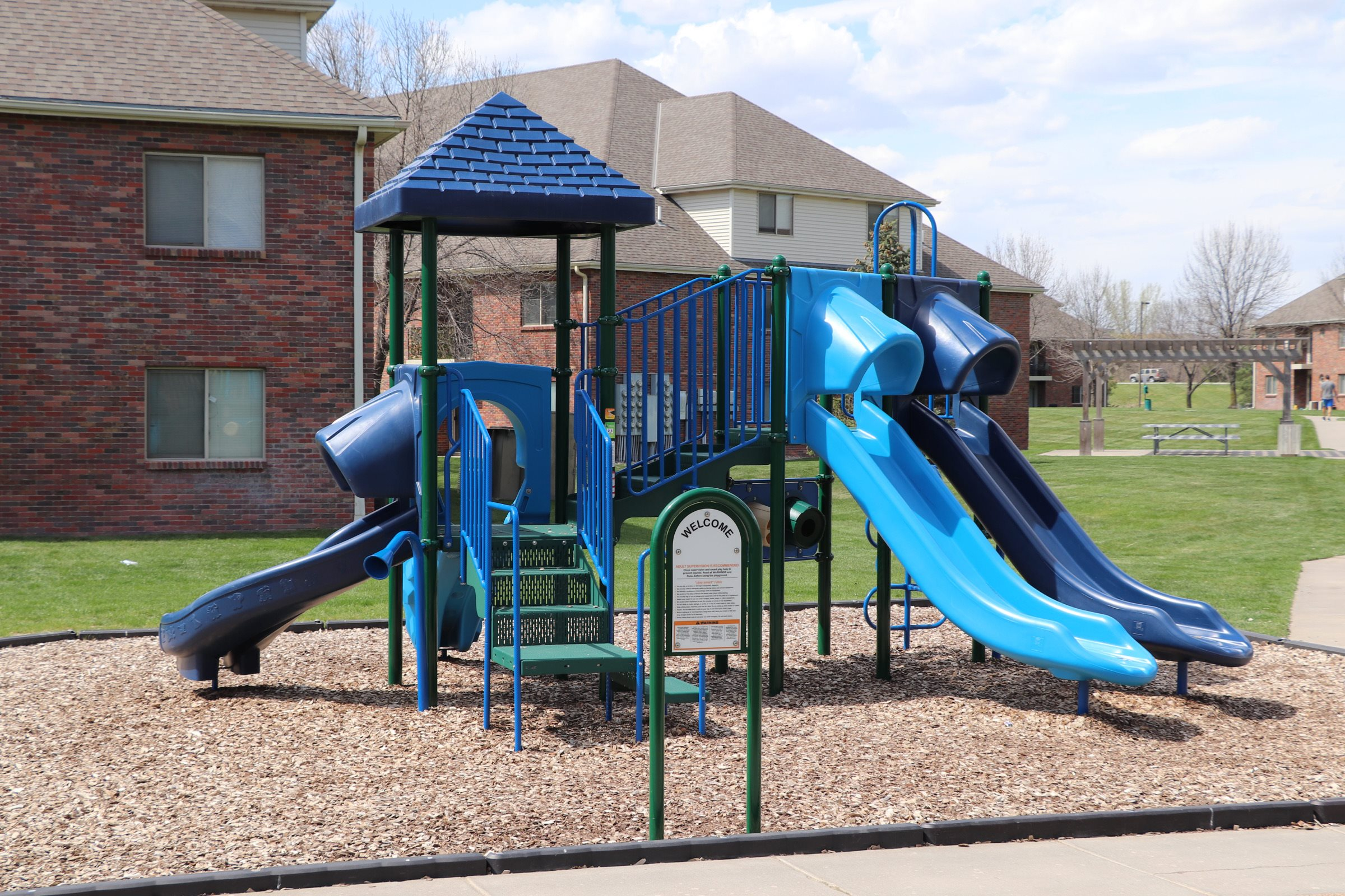 Children's playground with slides at Fountain Glen Apartments in Lincoln, NE