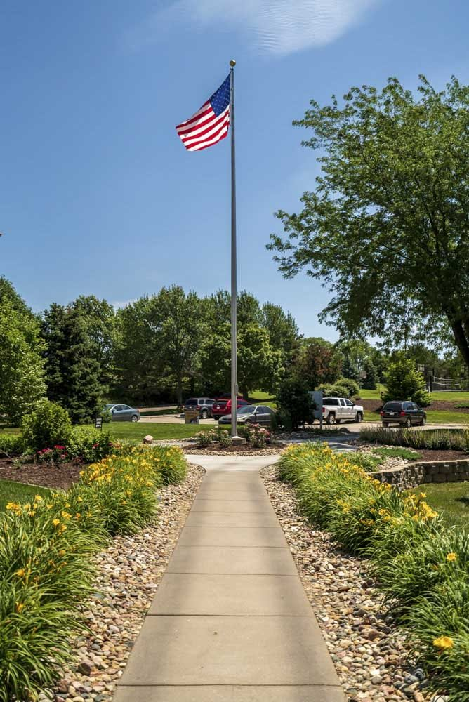 Flag pole with the United States Flag at Fountain Glen Apartments