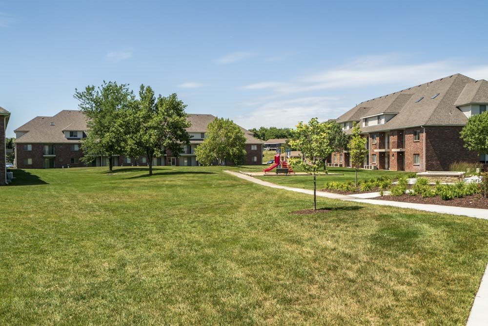 Large green space and park at Fountain Glen Apartments