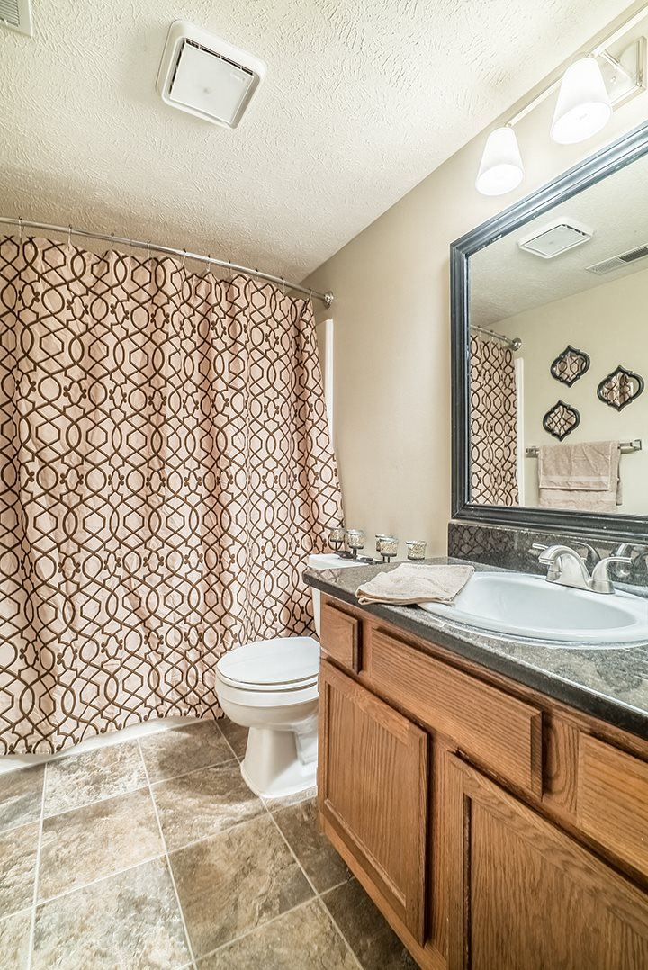 Renovated bathroom with a bathtub at Fountain Glen Apartments