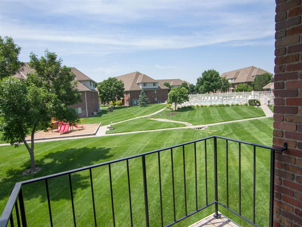 view from balcony looking over large green space at Fountain Glen Apartments in Lincoln Nebraska