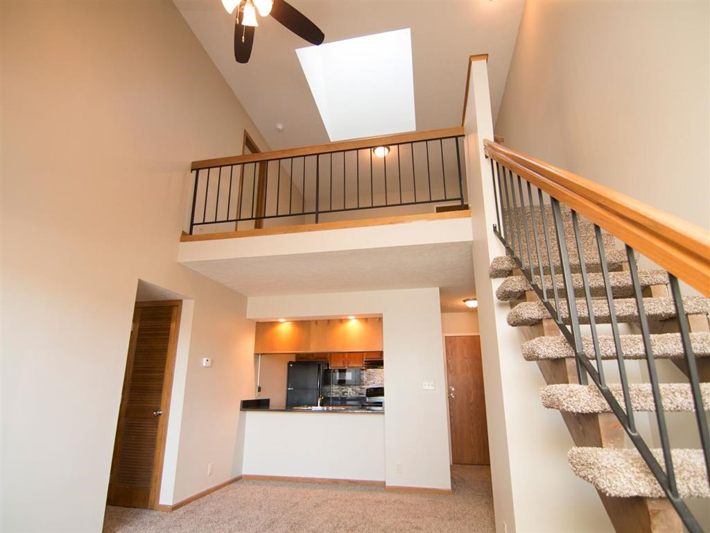 Kitchen and stairs at Fountain Glen Apartments in Lincoln Nebraska