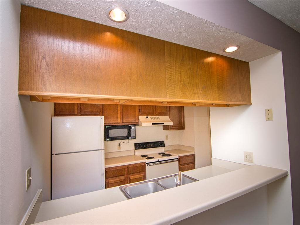 kitchen and refrigerator at Fountain Glen Apartments in Lincoln Nebraska
