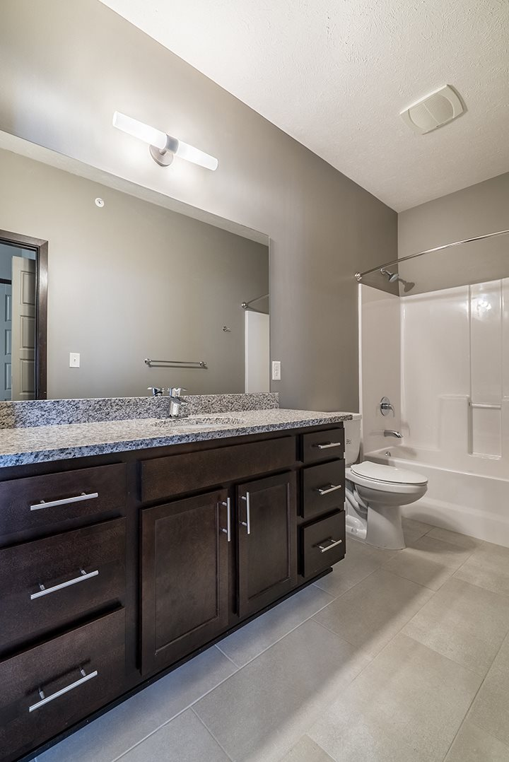 Large bathroom with granite countertops and a bathtub at North Pointe Villas