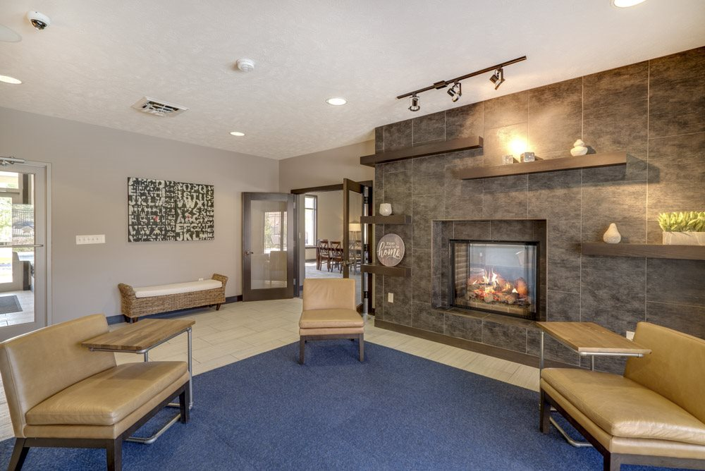 Leasing lounge in east clubhouse with fireplace at North Pointe Villas luxury townhomes for rent in north Lincoln NE