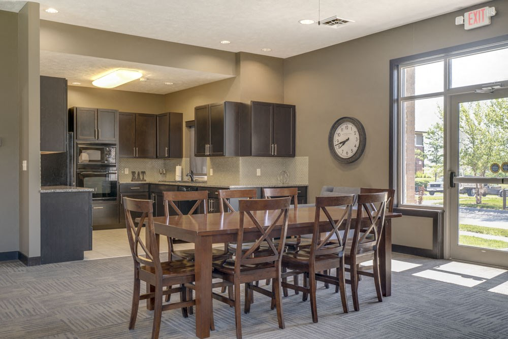 Resident kitchen and table in east clubhouse at North Pointe Villas luxury apartments for rent in North Lincoln NE