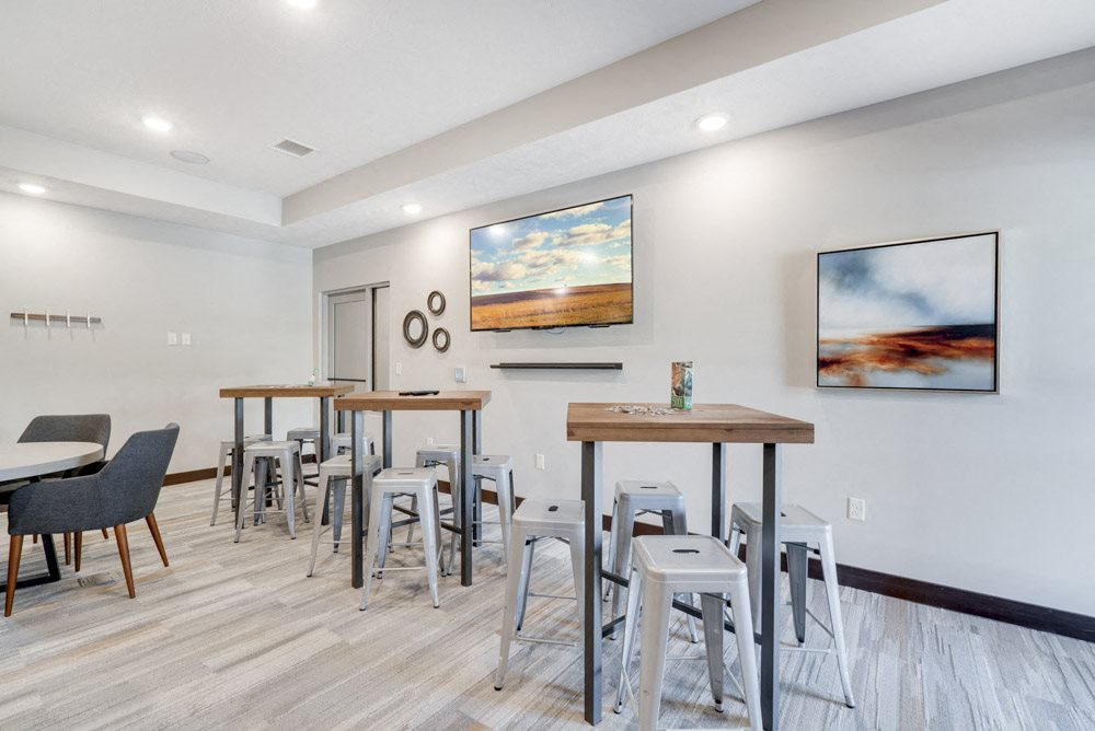 Bar top tables with puzzles and card games at the new west clubhouse at NOrth Pointe Villas luxury apartments in north Lincoln NE